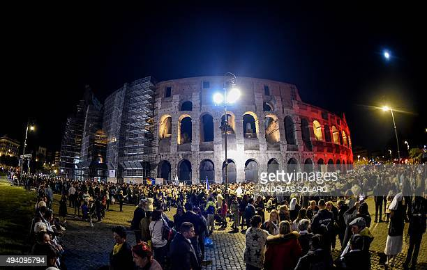 Members of the Roma community and traveller communities attend celebrations of the Via Crucis outside the Colosseum in central Rome on October 24...