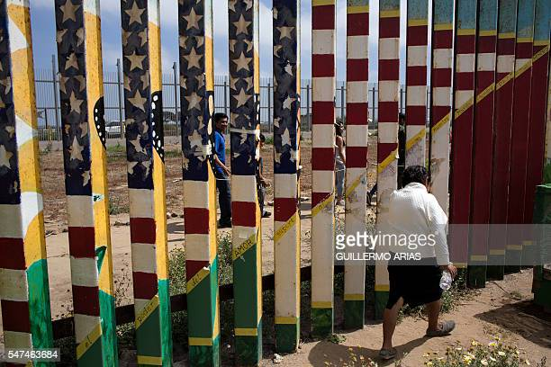 Members of the Rosete Quintana family gather both sides of the US Mexico border at Playas de Tijuana in Tijuana northwestern Mexico on July 2 2016...
