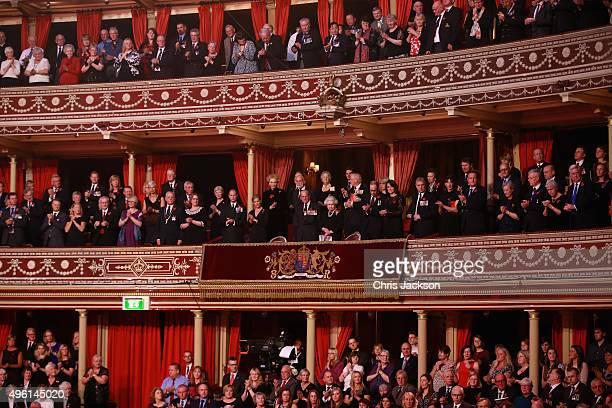 Members of the Royal Box and guests stand as the Chelsea Pensioners arrive into the Royal Albert Hall during the Annual Festival of Remembrance on...