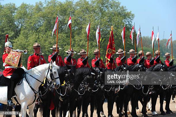Members of the Royal Canadian Mounted Police parade with British Guards on Horse Guards Parade in central London on May 23 as the RCMP take part in...
