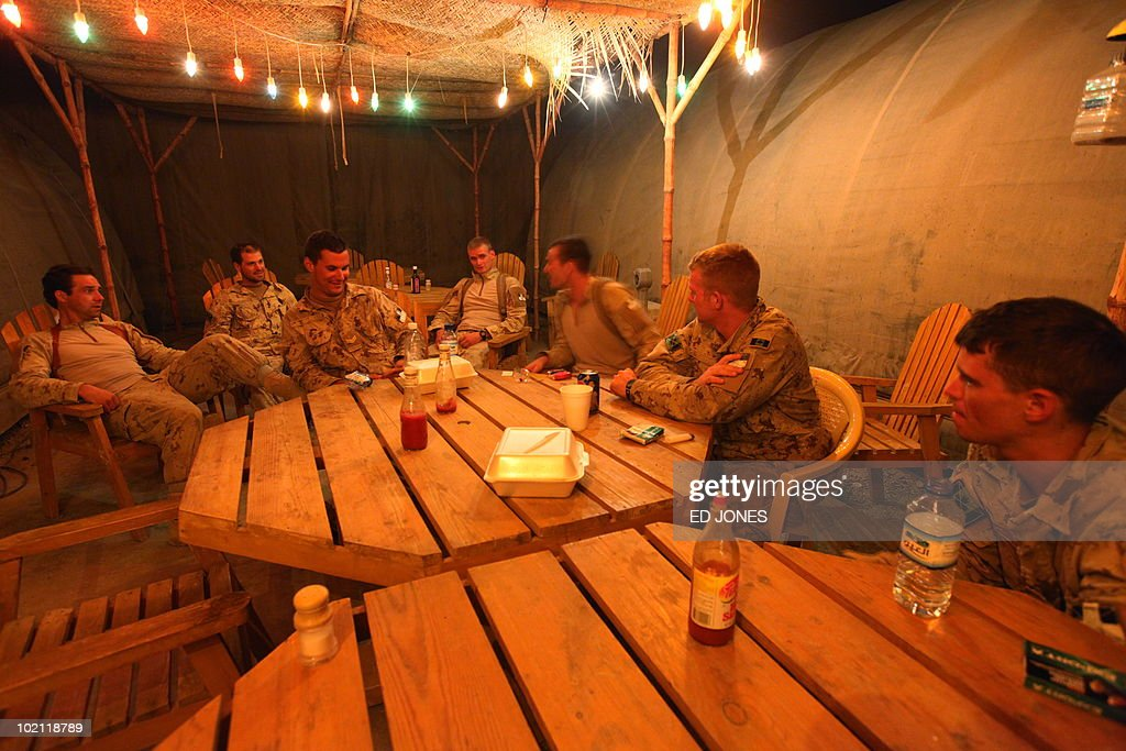 Members of the Royal Canadian Regiment relax at Camp Nathan Smith in Kandahar City on June 15, 2010. The same day a district chief, his son and a bodyguard were killed by a car bomb in southern Afghanistan's Taliban heartland of Kandahar City, police said.