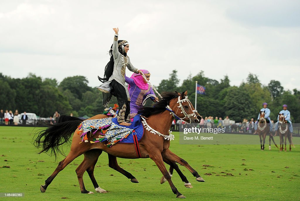 Members of the Royal Cavalry of Oman perform at the Cartier Queen's Cup Polo Day 2012 at Guards Polo Club on June 17, 2012 in Egham, England.