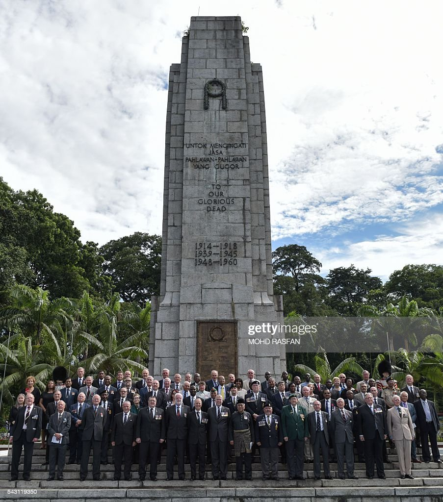 Members of the Royal Commonwealth Ex-Services League (RCEL) pose for pictures in front of the cenotaph during a service of remembrance ceremony at the National Monument in Kuala Lumpur on June 26, 2016. The Royal Commonwealth Ex-Services League (RCEL) is a Commonwealth charity with 57 member organisations in 50 Commonwealth countries, including Malaysia. Malaysia was chosen to be the host of its 32nd conference from June 26 to 29. / AFP / MOHD