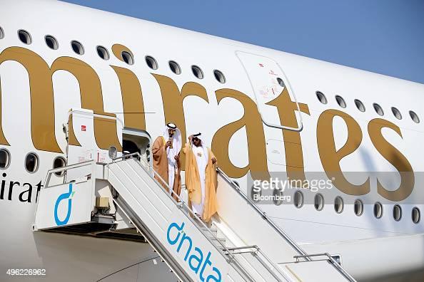Members of the Royal entourage of Sheikh Mohammed bin Rashid Al Maktoum the ruler of Dubai exit following a tour of an Airbus A380800 aircraft...
