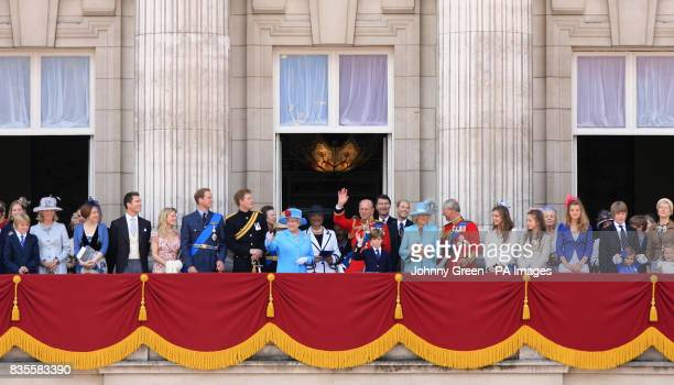 Members of the royal family including Prince William Prince Harry The Princess Royal Vice Admiral Timothy Lawrence Queen Elizabeth II Princess...