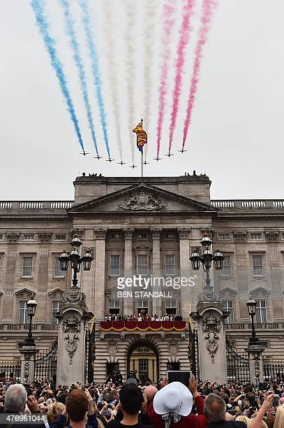 Members of the royal family line the balcony of Buckingham Palace as spectators watch the Royal Air Force Aerobatic Team the Red Arrows perform a...