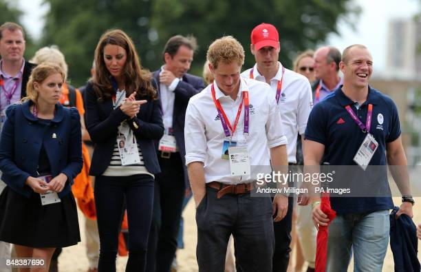 Members of the Royal family Princess Beatrice The Duchess of Cambridge Prince Harry The Duke of Cambridge and Mike Tindall after Great Britain's Zara...