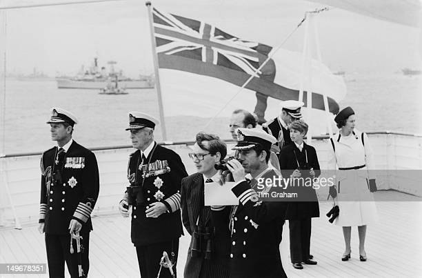 Members of the royal family standing on board the royal yacht Britannia during a Jubilee naval review at Spithead UK 28th June 1977 From left to...