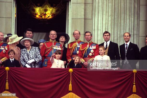 Members of the Royal Family watch the traditional flypast from the balcony of Buckingham Palace following the Trooping of the Colour in honour of the...