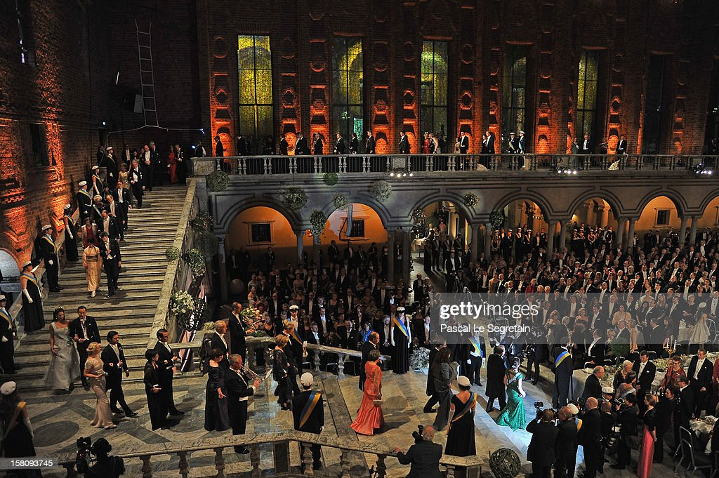 Members of the Royal family, with Crown Princess Victoria of Sweden (in green evening dress at bottom right) and Nobel Prize laureates walk down the stairs as they arrive for Nobel Banquet at Town Hall on December 10, 2012 in Stockholm, Sweden.