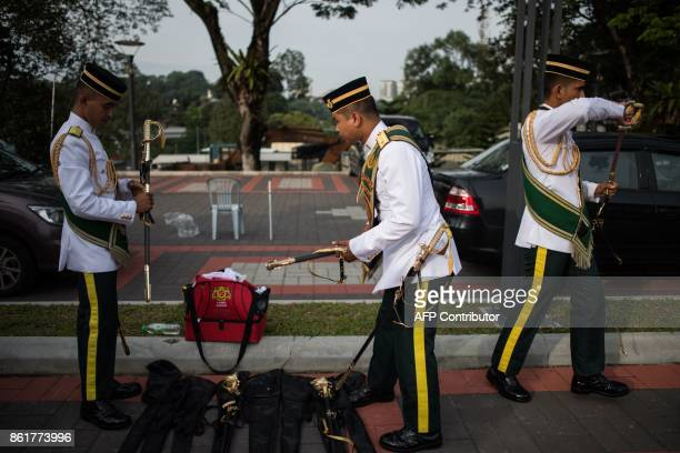Members of the Royal Malay Regiment Guard of Honour prepare for the welcoming ceremony of Qatar's Emir Sheik Tamim bin Hamad alThani at the...