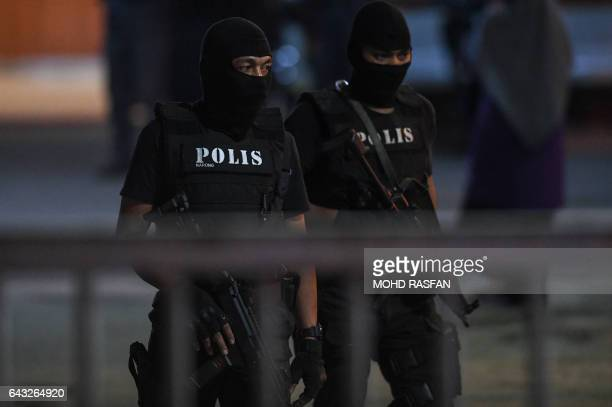 Members of the Royal Malaysian Police special operation forces keep watch inside the forensics wing of the Hospital Kuala Lumpur in the Malaysian...