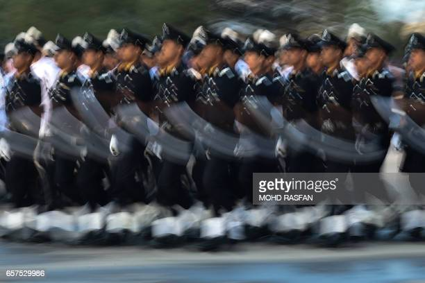 TOPSHOT Members of the Royal Malaysian Police take part in the 210th Police Day parade in Kuala Lumpur on March 25 2017 Some 1000 police took part in...