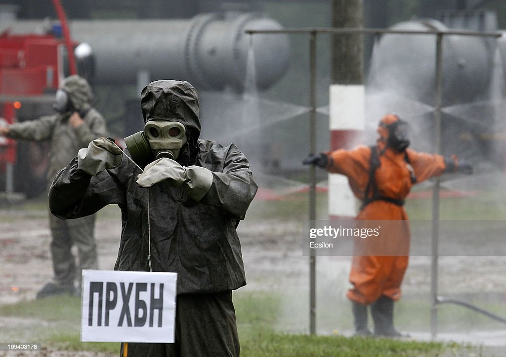 Members of the Russian Emergency Situations Ministry wear protective clothing during simulation exercises by the Russian Emergency Situations Ministry, at their Rescue Training Centre on May 24, 2013 in Noginsk, outside Moscow, Russia.