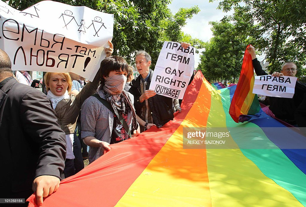Members of the Russian gay community and gay rights activists from Europe hold flags during a banned gay rally in Moscow on May 29, 2008. The activists plan to hold a parade in Moscow every year, but the action is routinely banned by city authorities and the parade attempts end in arrests and fist fights.