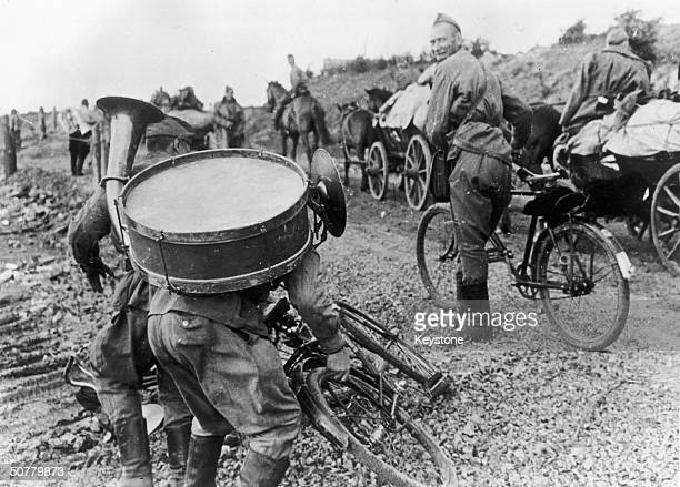 Members of the Russian Red Army band cycle along the BerlinHanover autobahn on their way to occupy the 'Magdeburg Bulge' during the readjustment of...