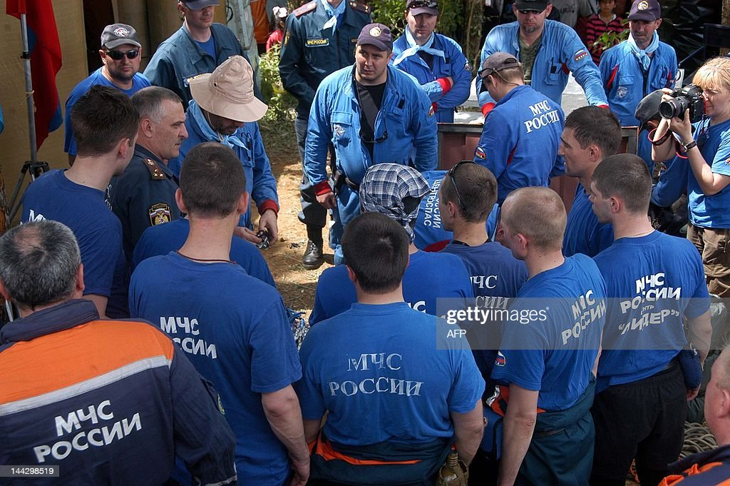Members of the Russian search and rescue team attend a briefing at the operation base in Cijeruk village on May 13 before going to the crash site of...