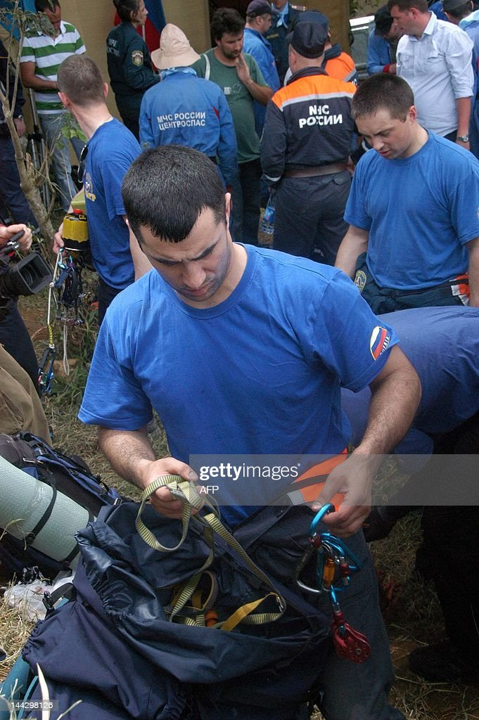 Members of the Russian search and rescue team prepare their equipment at the operation base in Cijeruk village on May 13 before going to the crash...