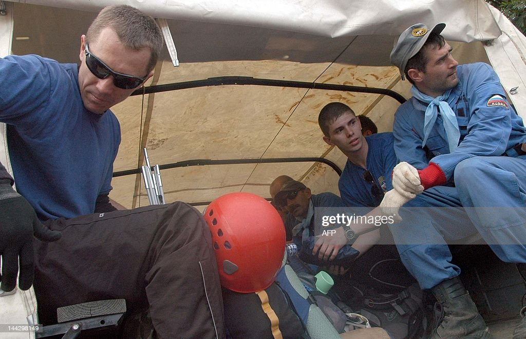 Members of the Russian search and rescue team sit in a truck at the operation base in Cijeruk village on May 13 before going to the crash site of the...