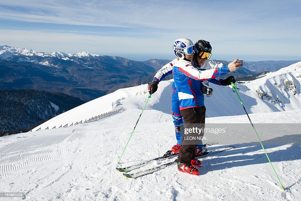 Members of the Russian Ski Cross Team pose for a self-portrait at the peak of Mount Aigba, at Rzhanaya Polyana near the Black Sea resort of Sochion February 14, 2013. With a year to go until the Sochi 2014 Winter Games, construction work continues as tests events and World Championship competitions are underway.