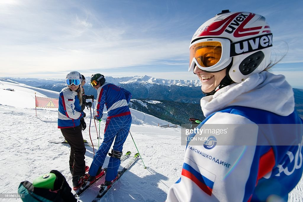 Members of the Russian Ski Cross Team prepare to set off from the peak of Mount Aigba, at Rzhanaya Polyana near the Black Sea resort of Sochion February 14, 2013. With a year to go until the Sochi 2014 Winter Games, construction work continues as tests events and World Championship competitions are underway.