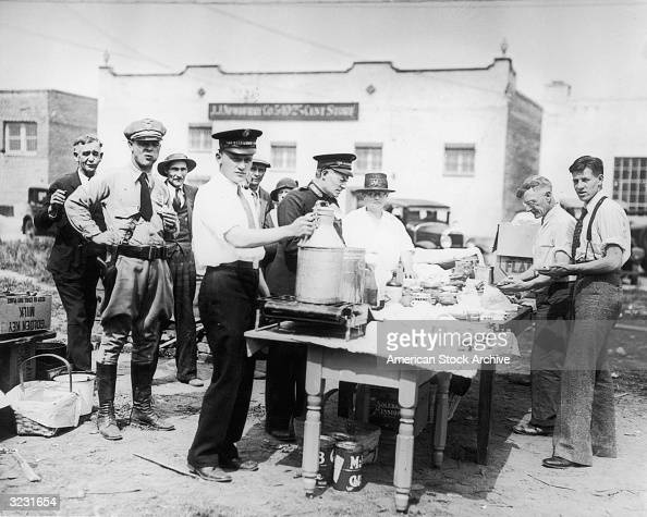 Members of the Salvation Army operate a soup kitchen outdoors in a vacant lot during the Great Depression