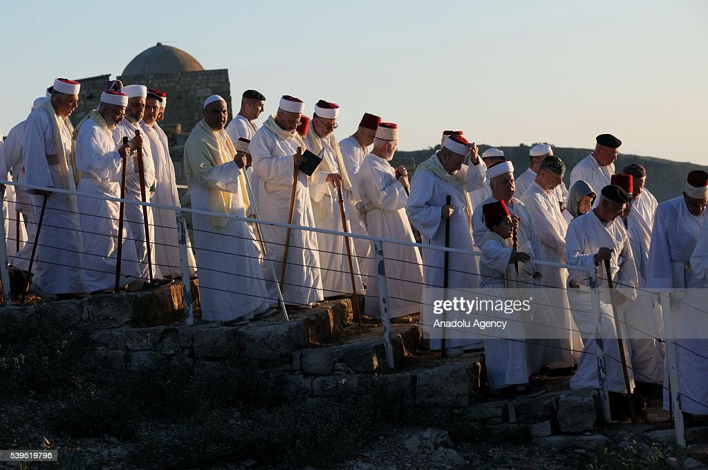 Members of the Samaritan community celebrate revelation of Torah during a ceremony on top of Mount Gerizim in Nablus West Bank on June 12 2016...
