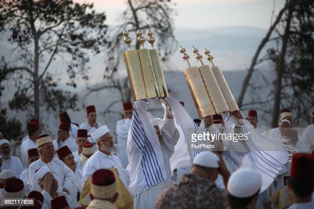 Members of the Samaritan sect take part in a traditional pilgrimage marking the holiday of Shavuot atop Mount Gerizim near the West Bank city of...