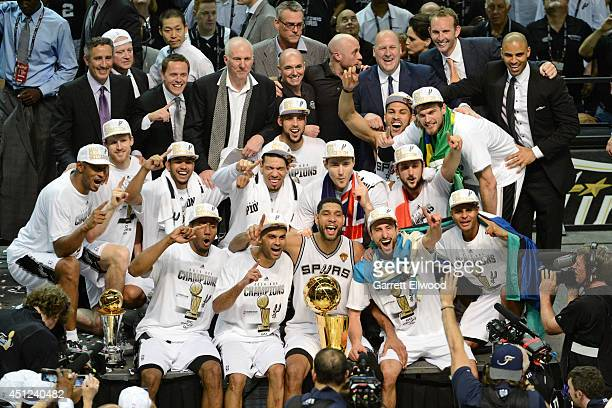 Members of the San Antonio Spurs pose for a picture after thier win against the Miami Heat during Game Five of the 2014 NBA Finals between the Miami...