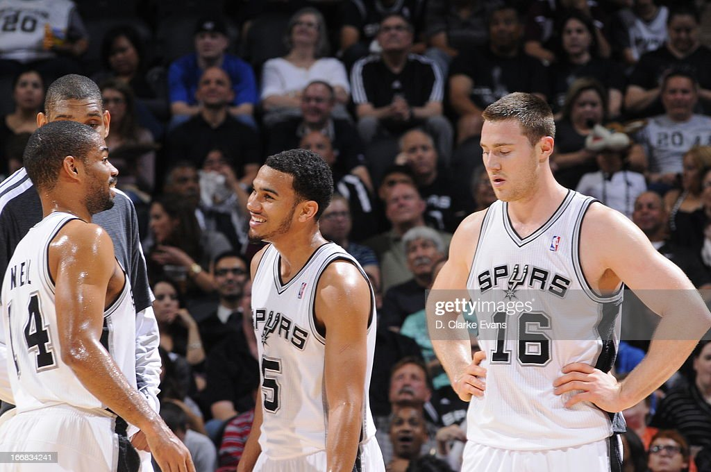 Members of the San Antonio Spurs smile as they speak with eachother against the Minnesota Timberwolves on April 17, 2013 at the AT&T Center in San Antonio, Texas.