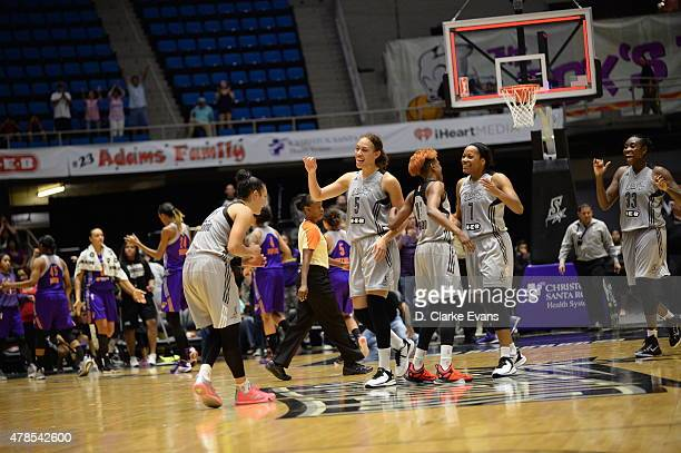 Members of the San Antonio Stars celebrate on the court after the game against the Phoenix Mercury on June 25 2015 at Freeman Coliseum in San Antonio...