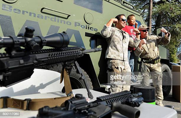 Members of the San Bernardino SWAT team pose for pictures during the annual Christmas parade on December 5 2015 in San Bernardino The parade went on...