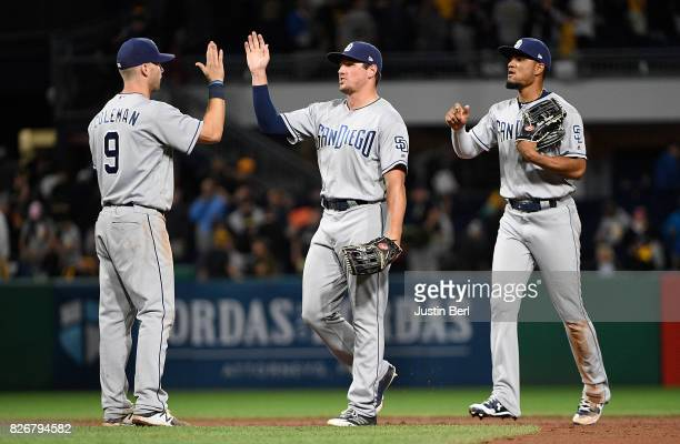 Members of the San Diego Padres celebrate after the final out in the San Diego Padres 52 win over the Pittsburgh Pirates at PNC Park on August 5 2017...