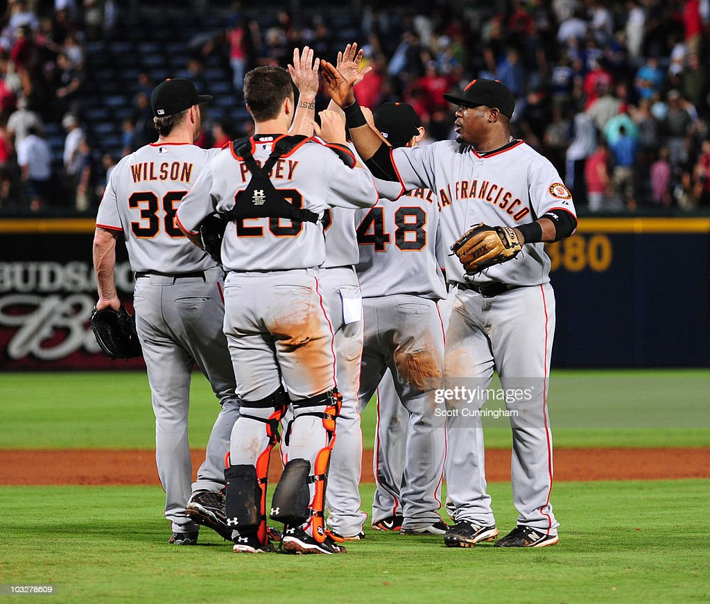 Members of the San Francisco Giants celebrate after the game against the Atlanta Braves at Turner Field on August 6, 2010 in Atlanta, Georgia. The Giants defeated the Braves 3-2.