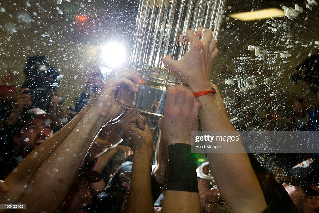 Members of the San Francisco Giants hold up the World Series trophy as they celebrate after their 3-1 victory to win the World Series over the Texas Rangers in Game Five of the 2010 World Series at Rangers Ballpark on Monday, November 1, 2010 in Arlington, Texas.