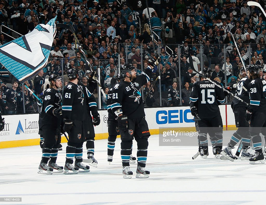 Members of the San Jose Sharks salute the crowd after a victory against the Los Angeles Kings in Game Four of the Western Conference Semifinals during the 2013 Stanley Cup Playoffs at HP Pavilion on May 21, 2013 in San Jose, California.