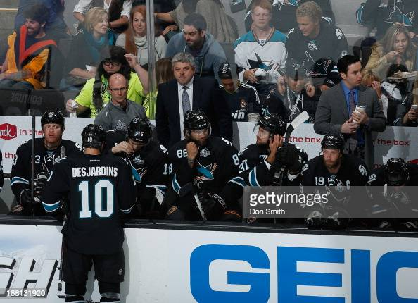 Members of the San Jose Sharks sit on the bench during a game against the Vancouver Canucks in Game One of the Western Conference Quarterfinals...