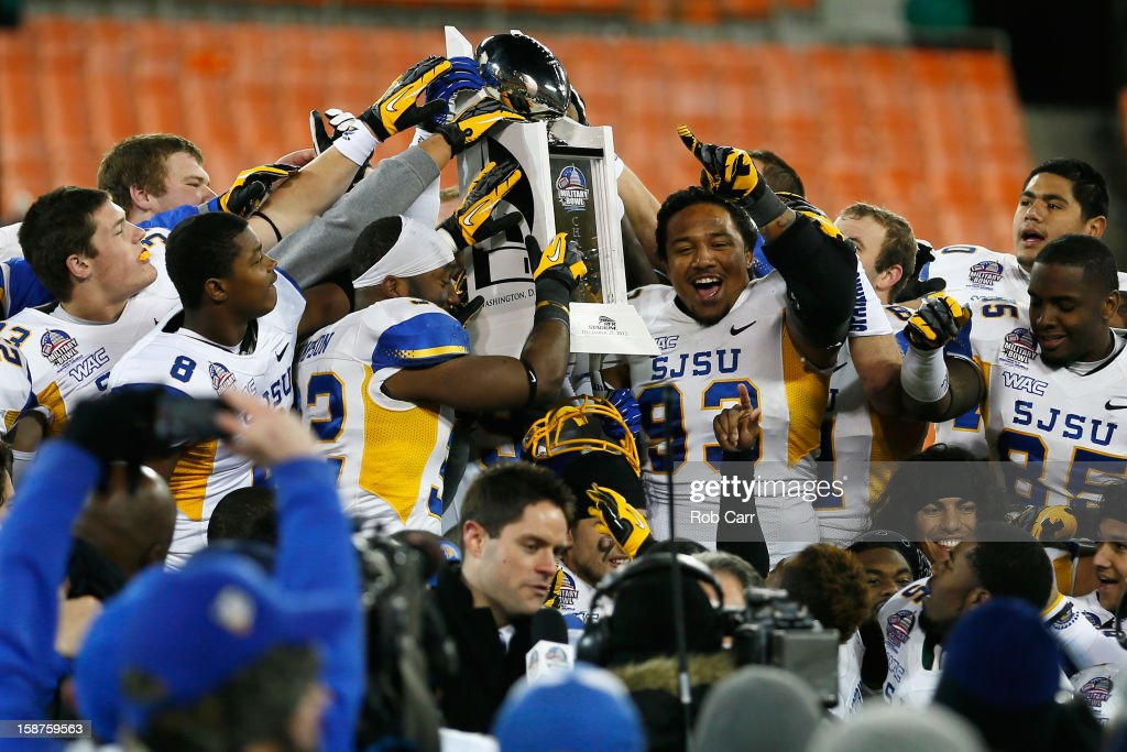 Members of the San Jose State Spartans hold up the trophy after defeating the Bowling Green Falcons 2920 to win the Military Bowl at RFK Stadium on...