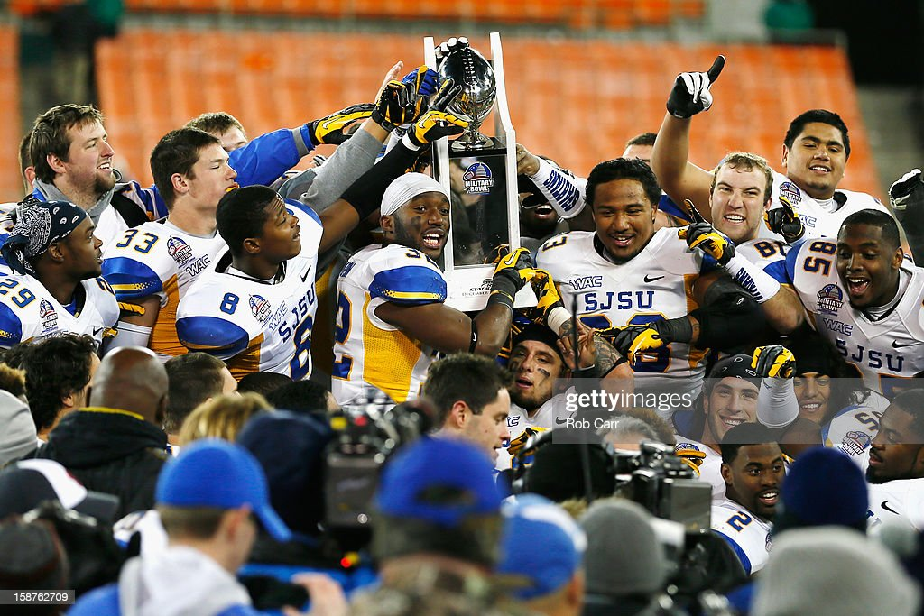 Members of the San Jose State Spartans hold up the trophy after defeating the Bowling Green Falcons 29-20 to win the Military Bowl at RFK Stadium on December 27, 2012 in Washington, DC.