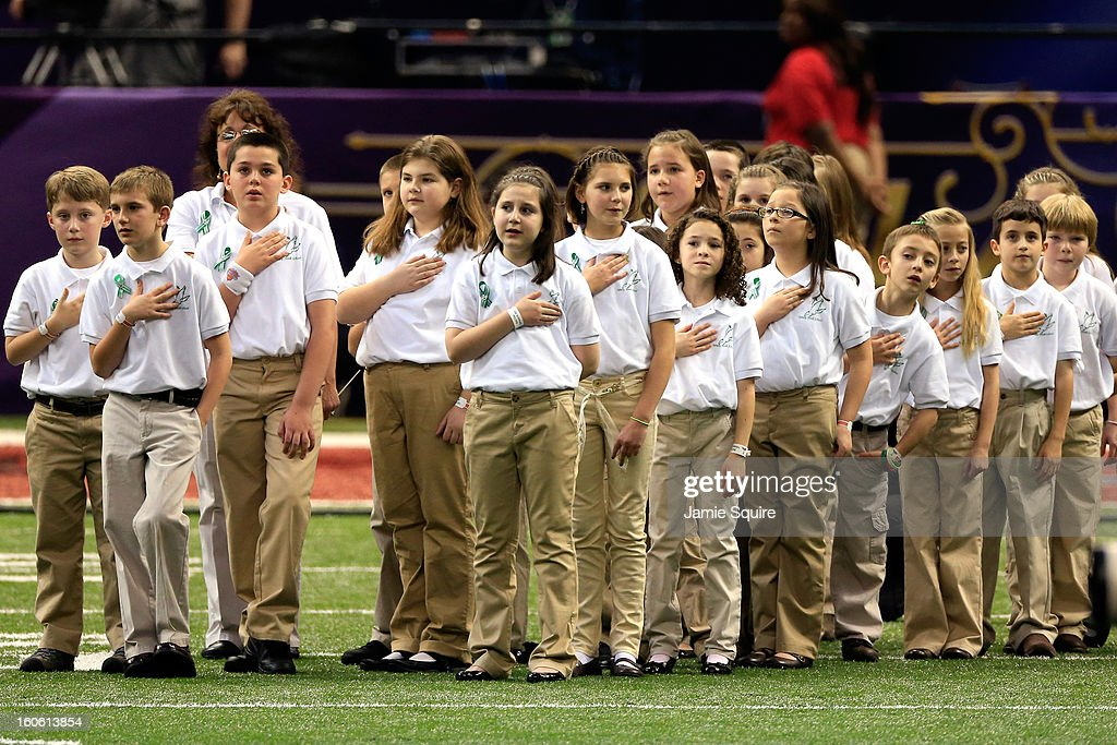 Members of the Sandy Hook Elementary School Chorus look on during the National Anthem prior to Super Bowl XLVII between the San Francisco 49ers and the Baltimore Ravens at the Mercedes-Benz Superdome on February 3, 2013 in New Orleans, Louisiana.