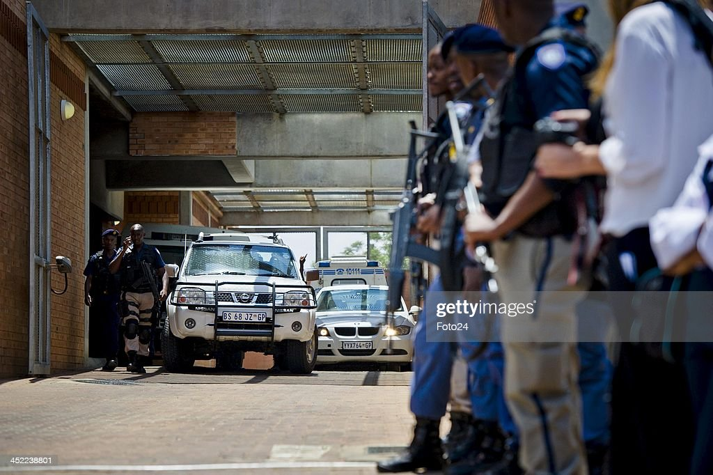 Members of the SAPD alongside journalists outside the Palm Ridge Magistrate's court on November 25, 2013, in Johannesburg, South Africa. Radovan Krejcir was arrested on November 22, 2013 on charges of kidnapping and attempted murder. Krejcir was allegedly assaulted during his arrest and had to be moved to a medical facility to receive treatment. The court was cleared out to omit the possibility of an attempted assassination.