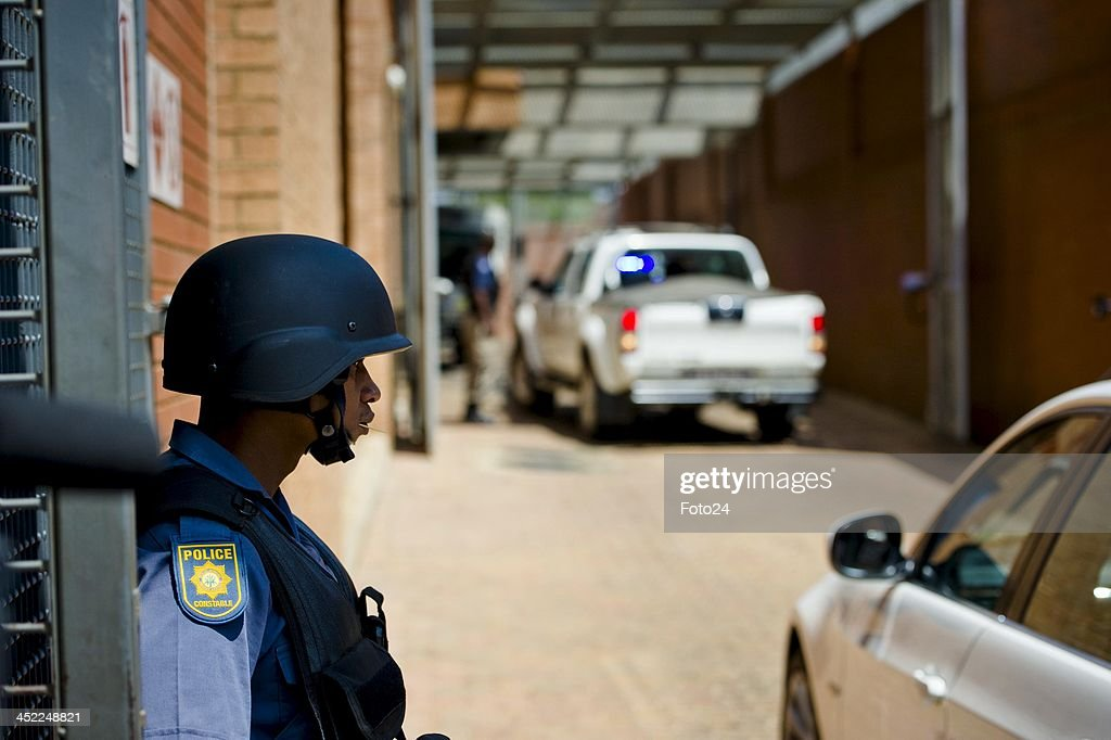 Members of the SAPD at the entrance of the Palm Ridge Magistrate's court on November 25, 2013, in Johannesburg, South Africa. Radovan Krejcir was arrested on November 22, 2013 on charges of kidnapping and attempted murder. Krejcir was allegedly assaulted during his arrest and had to be moved to a medical facility to receive treatment. The court was cleared out to omit the possibility of an attempted assassination.