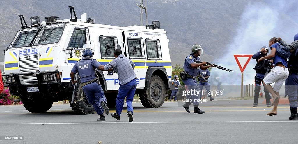 Members of the SAPD at the N1 De Doorns protest on January 9, 2013, in Cape Town, South Africa. The farm workers shut down the N1 by lighting tires on fire and placing large rocks on the road.