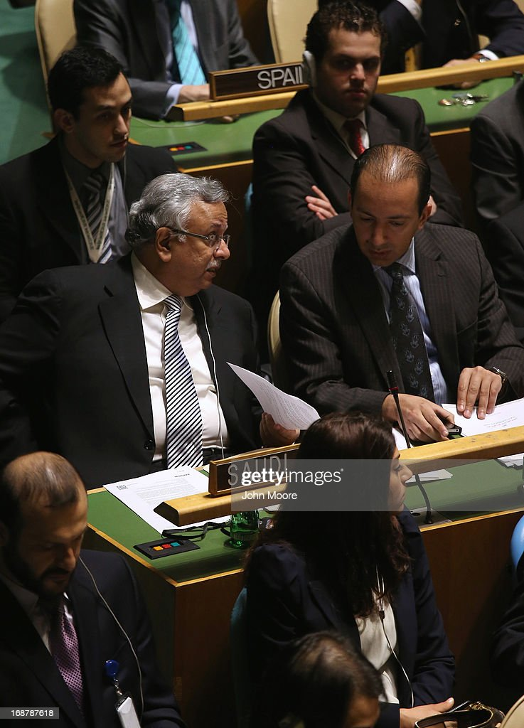 Members of the Saudi Arabian delegation await a vote at the United Nations calling for a political transition in Syria on May 15, 2013 in New York City. The 193-member UN General Assembly was to vote on an Arab-backed resolution condemning the regime of Syrian President Bashar Assad for human rights abuses and its escalating use of heavy weapons in the country's civil war.