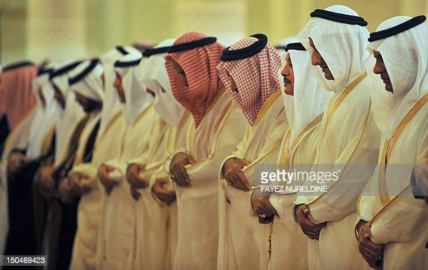 Members of the Saudi royal family perform prayer on the first day of Eid alFitr in the great mosque in the old City of Riyadh on August 19 2012 to...