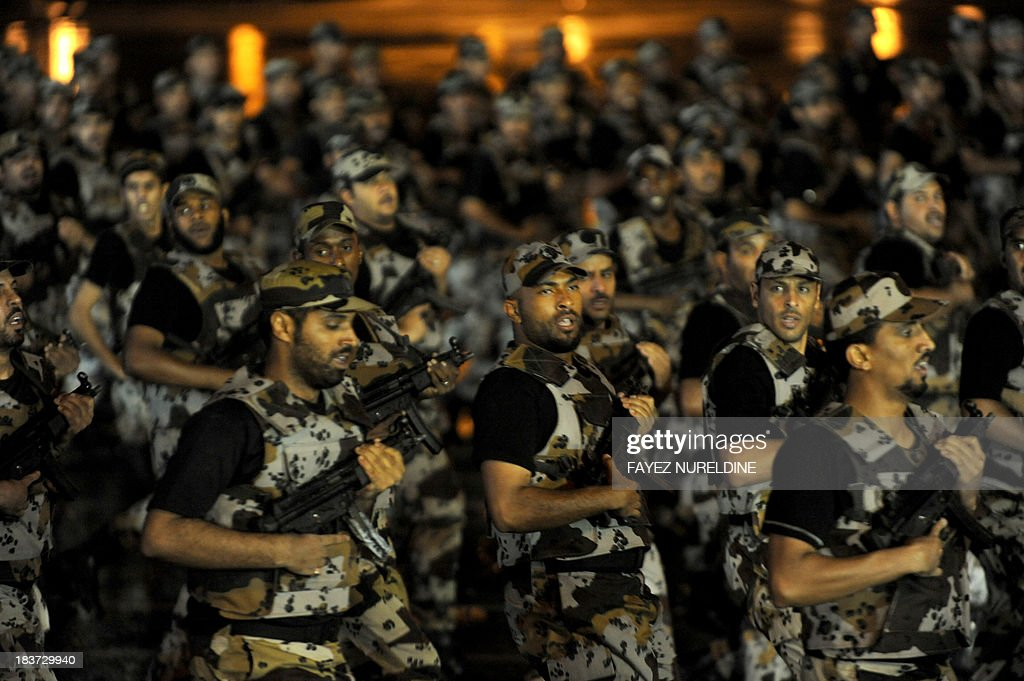 Members of the Saudi special police unit perform during a parade in Mecca, on October 9, 2013, as more than two million Muslims have arrived in the holy city in the lead up to the annual hajj pilgrimage. The hajj, which is one of the world's largest human assemblies, begins on October 13 amid concerns over the deadly MERS coronavirus. AFP PHOTO/FAYEZ NURELDINE