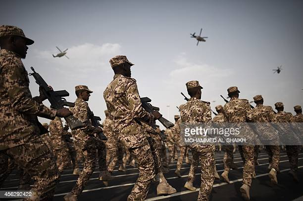 Members of the Saudi special police unit perform during a parade in Mecca on September 28 as more than one million Muslims have arrived in the holy...