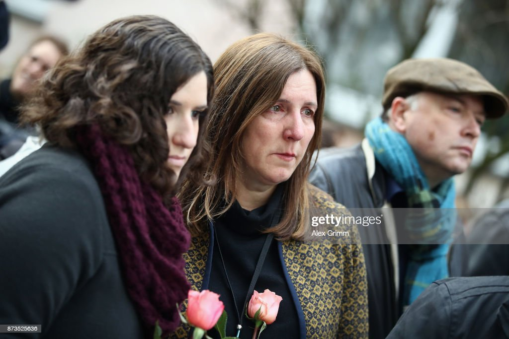 Members of the scattered Cohn family watch as German artist Gunter Demnig prepares to lay four stumbling stones' to commemorate Jewish schoolgirl and Holocaust victim Karolina Cohn and her family outside the building where they once lived on November 13, 2017 in Frankfurt, Germany. Karolina's fate came to light after Israeli archeologists digging at the former World War II Sobibor concentration camp found an amulet inscribed with Karolina's birthdate and birthplace, which helped them to confirm that she and her family were killed there. The Nazis deported Karolina, then 12, and her family to Minsk in 1941, though the rest of their journey had been unknown until now. Approximately 30 members of the Cohn family came from the United States, Israel, Japan and Canada to attend today's ceremonies. 'Stumbling stones,' in German called 'Stolpersteine,' are commemorative cobblestones affixed with a brass plate with the names of victims laid in the sidewalks outside the former residences of Jews in Germany killed in the Holocaust.