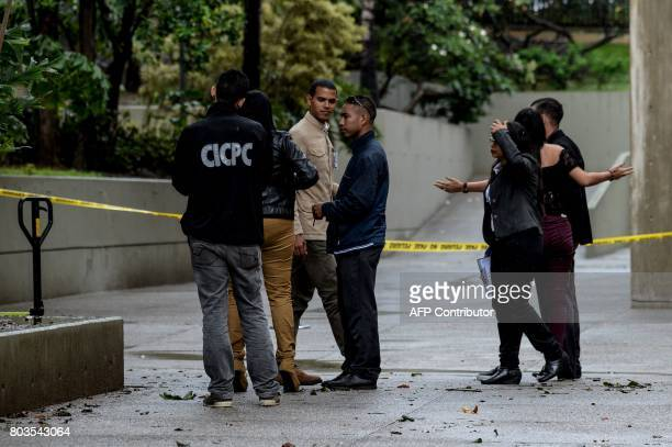 Members of the Scientific Police check the place where according to authorities grenades were thrown from a helicopter earlier this week at the...