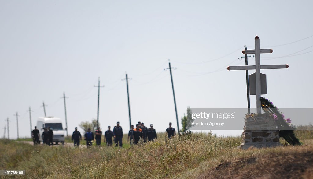 Members of the search and rescue team search the field around the crash site of the Malaysia Airlines flight MH17 near the Grabovo town in Donetsk, Ukraine on July 26, 2014.